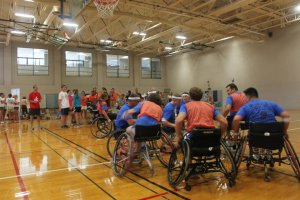 Teams playing wheelchair basketball