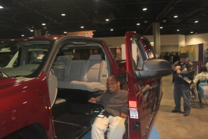 Testing the lift platform on a pick-up truck at the Abilities Expo