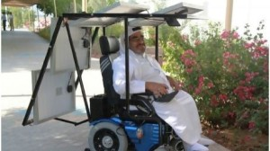 Frontal view of Haidar Taleb sitting in his solar-powered wheelchair