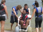 Preparing to get into the water with assistance from physical therapy students