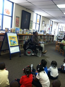 Reading to students at John L. Dart Library