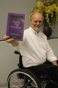 Gary Karp holding his book, Disability and the Art of Kissing.