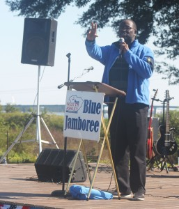 Rev. and Sen. Clamenta speaking at a Blue Jamboree rally.