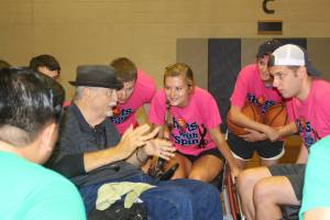 Gilbert Smith coaching a team on wheelchair basketball.