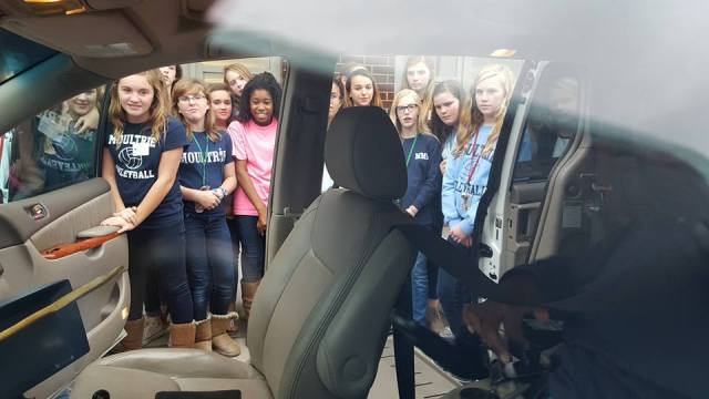 Women in Charge students taking a look in the van.
