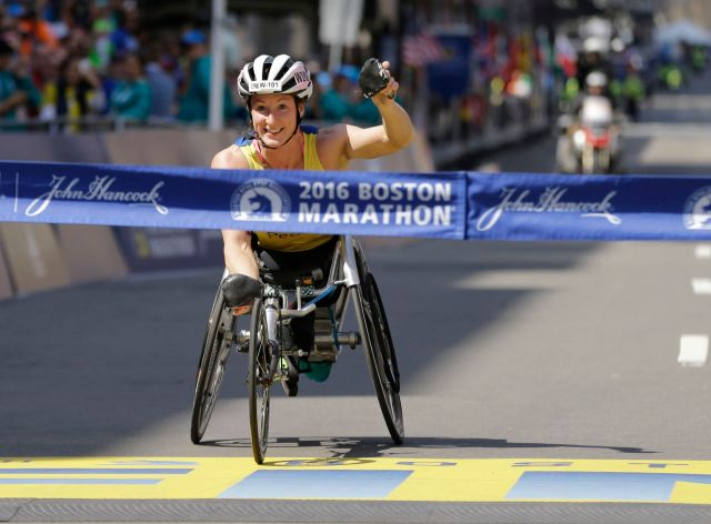 Tatyana McFadden, of Clarksville, Md., crosses the finish line to win the women's wheelchair division of the 120th Boston Marathon on Monday, April 18, 2016, in Boston. (AP Photo/Elise Amendola)