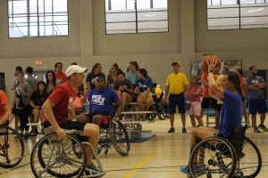 Physical therapists playing wheelchair basketball at MUSC Shots With A Spin