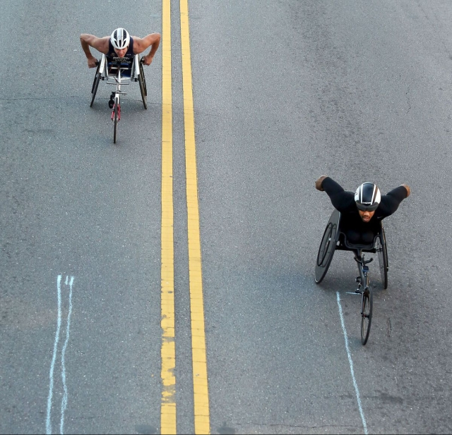 James Senbeta (right) and Krige Schabort nearing the finish line at the Cooper River Bridge Run. (Photo: Brad Nettles/Post and Courier)